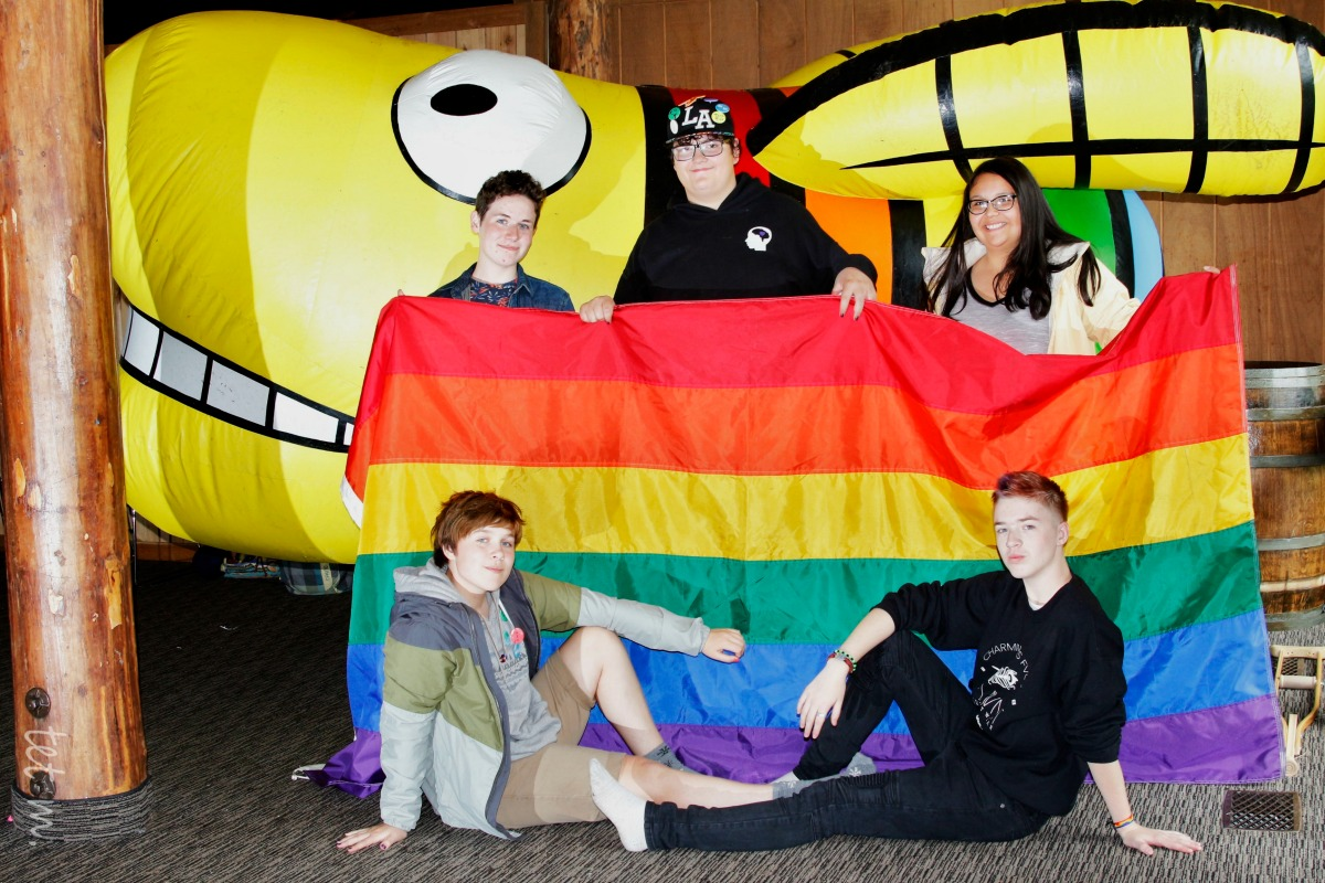 Campers with Pride Flag and inflatable firefly